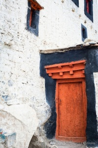 Old orange door at Buddhist monastery. India, Ladakh, Nubra Vall